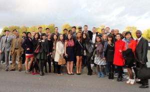 Students of Paris School of Business dine as they cruise the Seine River